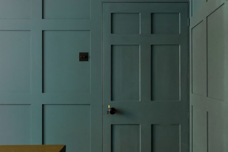 Green interior door and panelling