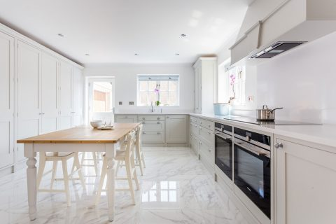 Shaker style kitchen near Bath with marble style flooring