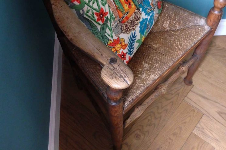Antique chair with bold print cushion