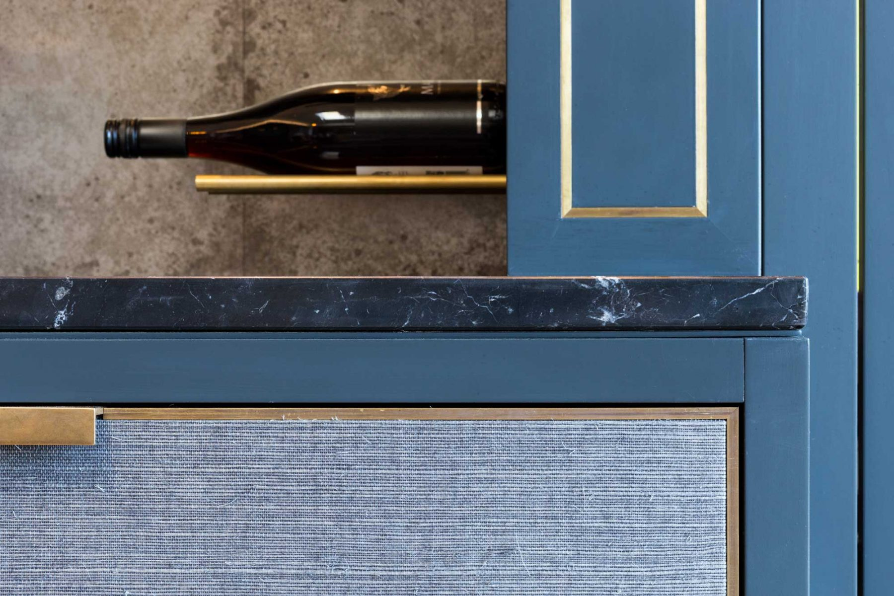 Wine wall with marble top and brass inlay designed by Mia Marquez