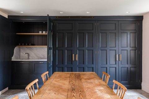 Traditional kitchen cabinets with concealed sink