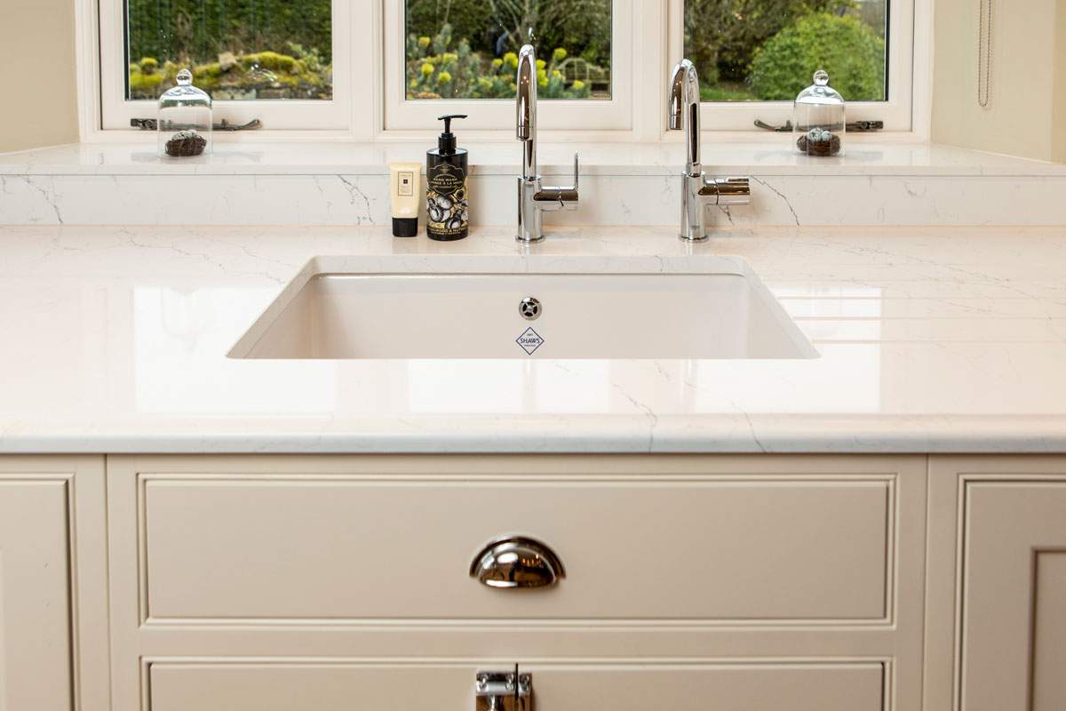 The sink area with an under mounted Shaw's ceramic sink