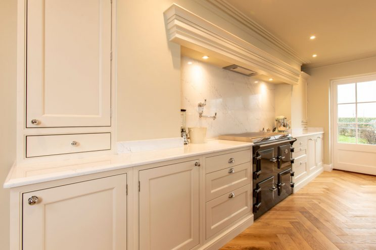 Walnut cabinets finished in Ha'Penny White