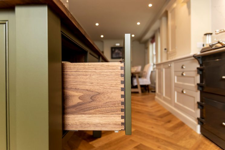 Walnut drawers in classic country kitchen