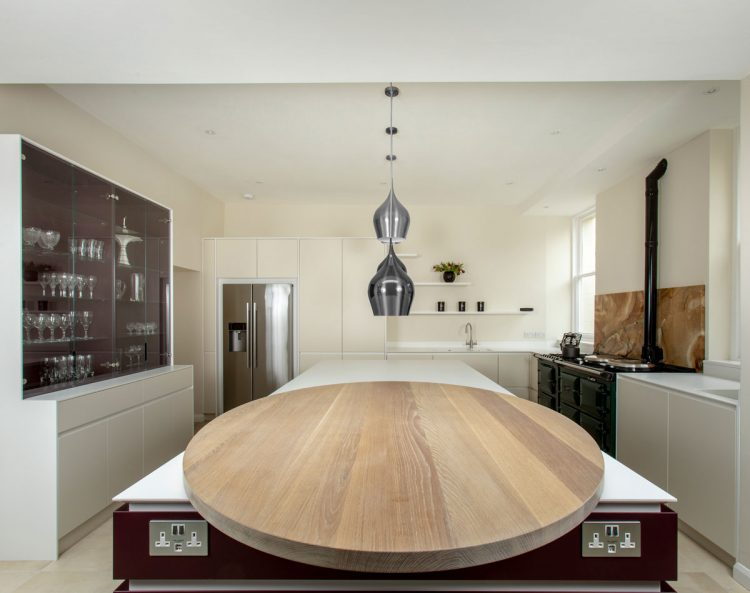 Modern Corian kitchen with island and solid oak breakfast bar