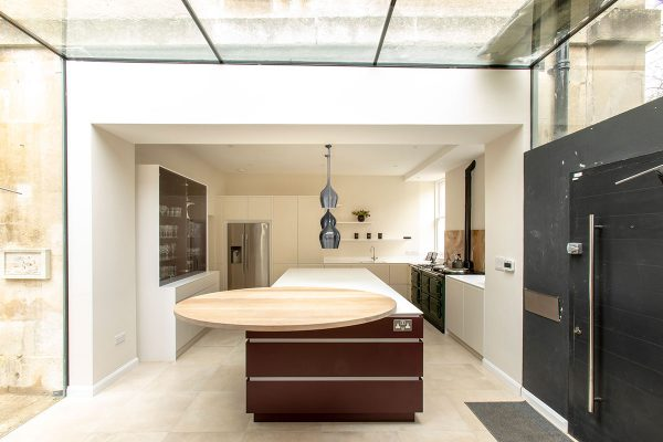 Modern Corian kitchen with island painted in Farrow and Ball Brinjal