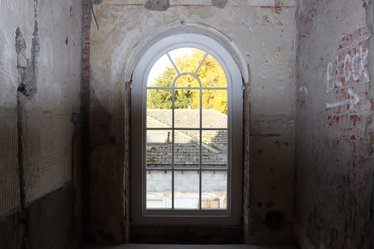 Arched sash window in a Georgian property