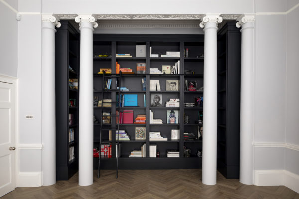 Library bookcase with secret door and ladder