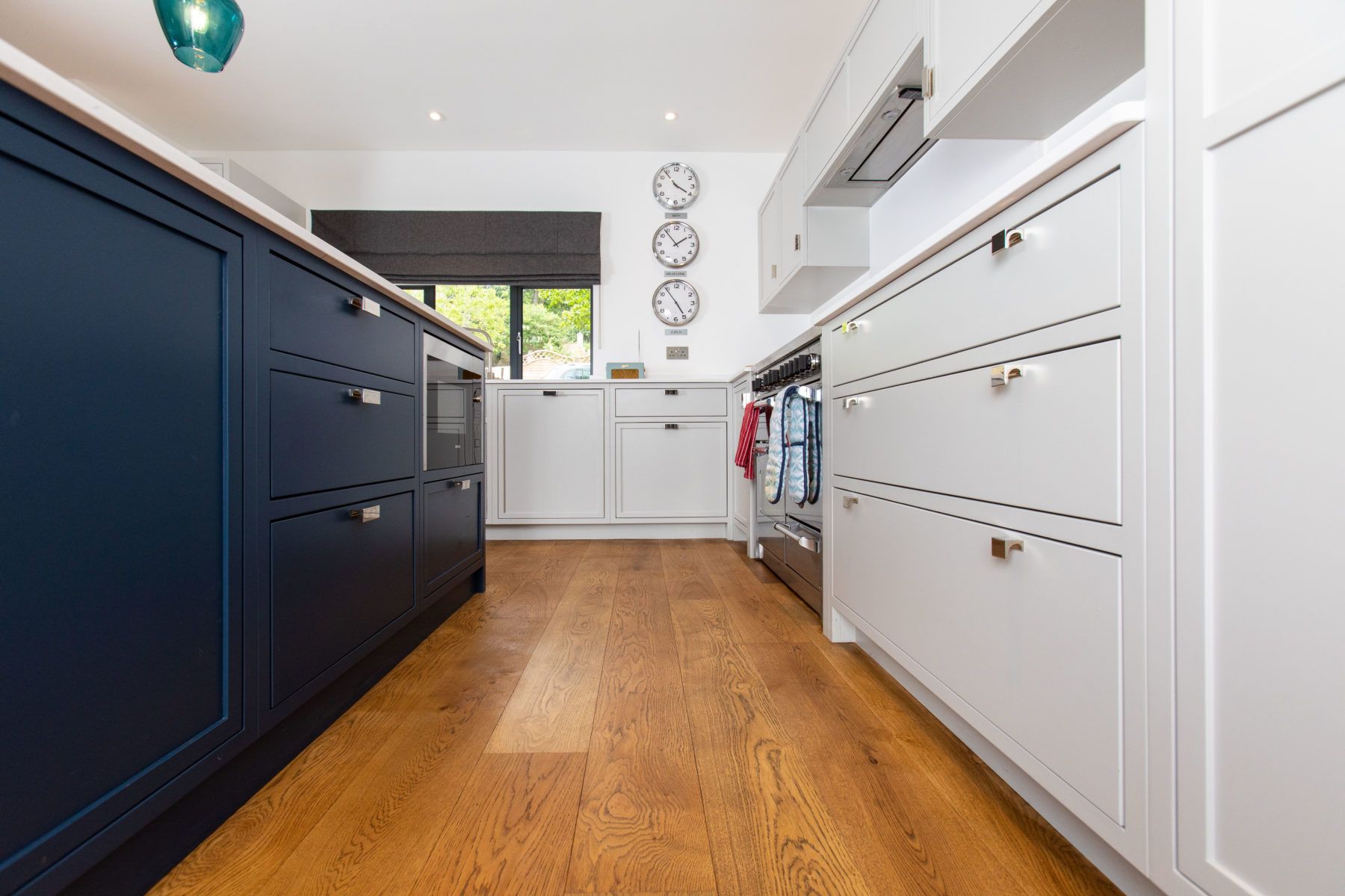 Modern Shaker kitchen with plank flooring