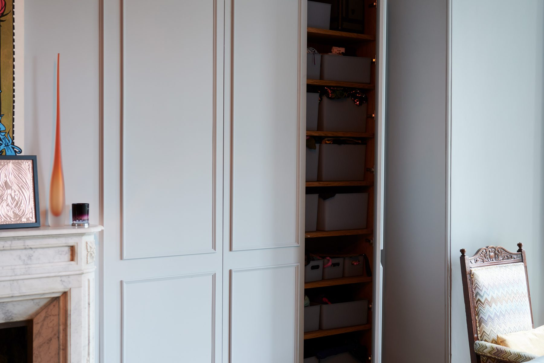 Concealed cupboard being bespoke wall panelling