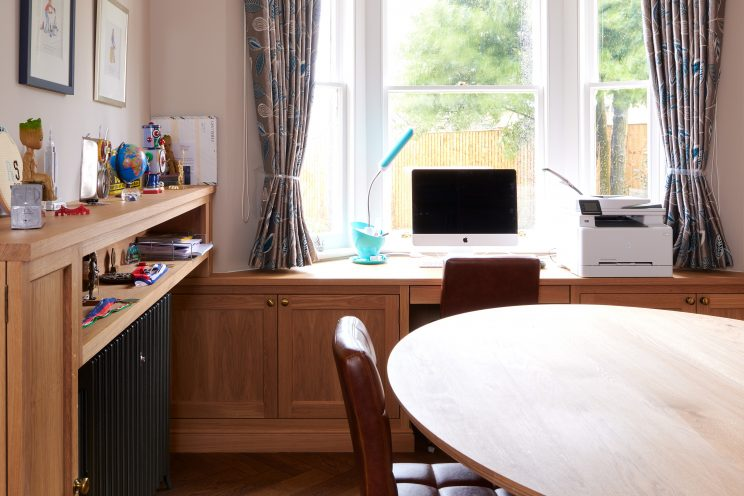 Home office with fitted desk and custom made oval table
