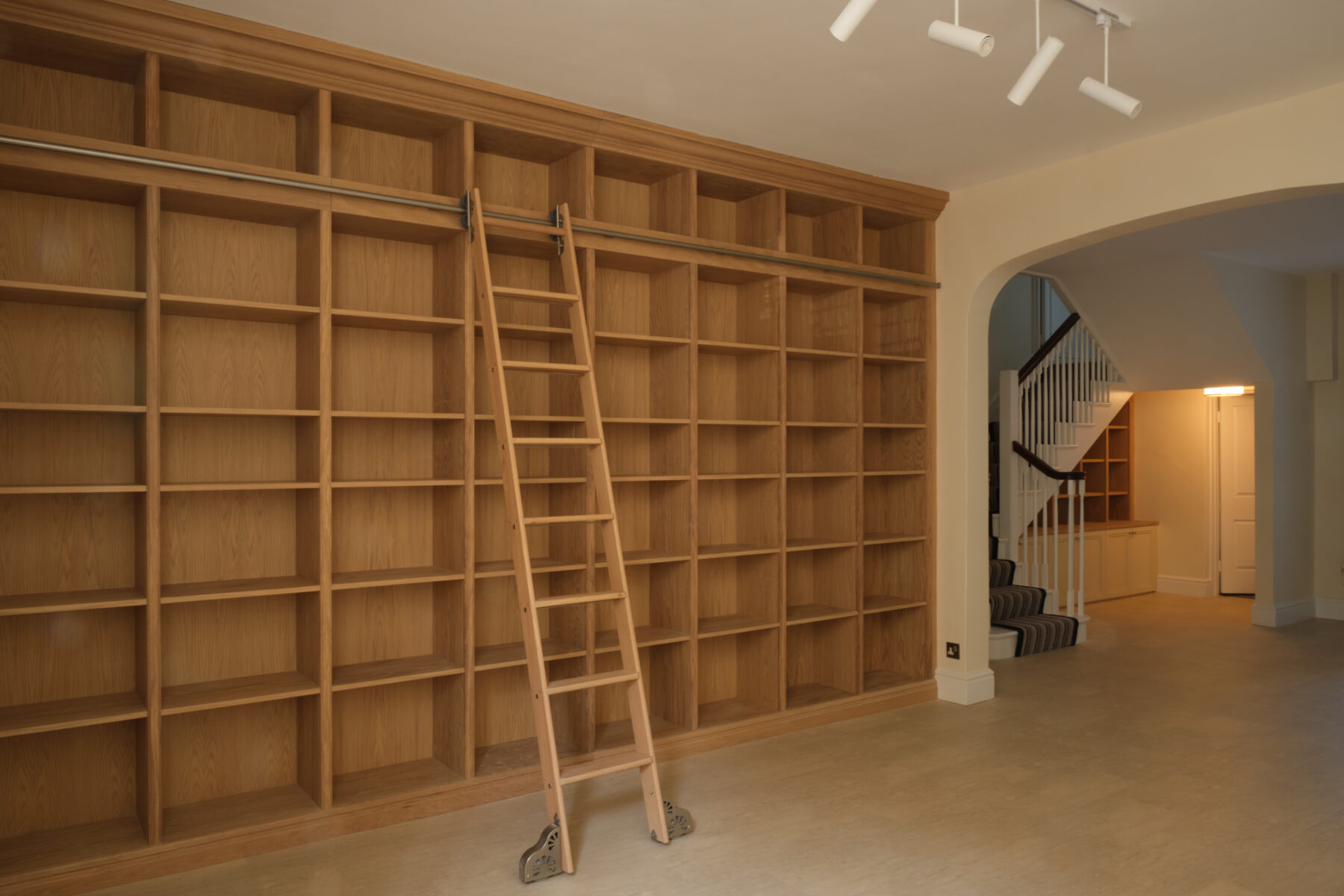 Bespoke library in oak with high-load, gliding ladder