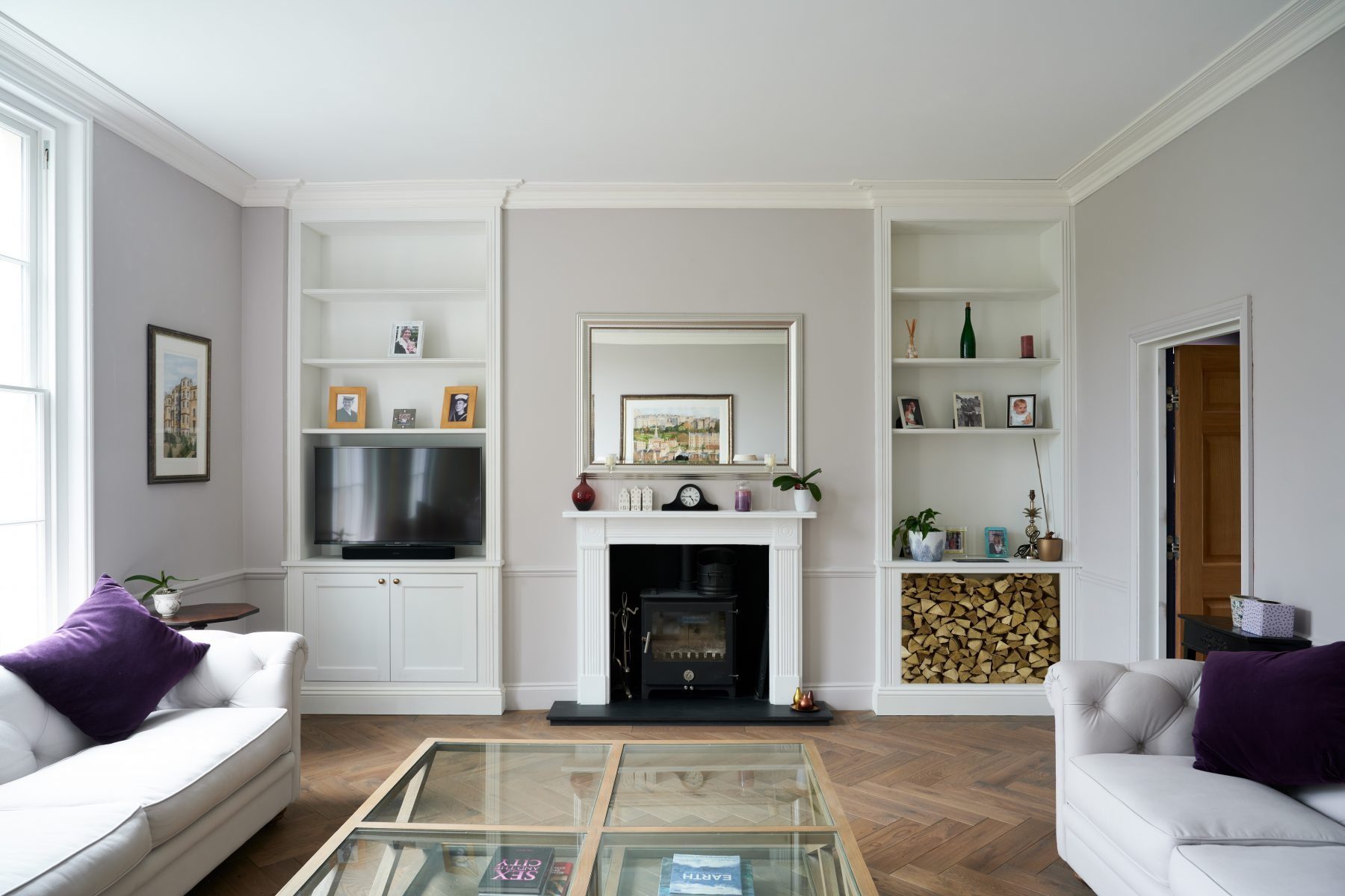 Alcove cabinetry incorporating log store